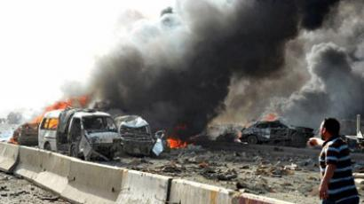 A handout picture released by the Syrian Arab News Agency (SANA) shows burning vehicles at the site of twin blasts in Damascus on May 10, 2012. (AFP Photo / Sana)