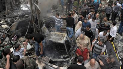 A handout picture released by the Syrian Arab News Agency (SANA) shows Syrians inspecting the site of an explosion in the Mazzeh district of the capital Damascus on November 5, 2012. (AFP Photo/SANA)