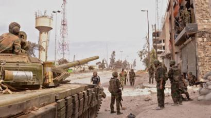 A unit of the Syrian armed forces carry out a military operation in the Khan al-Raslan neighbourhood of Syria's northern city of Aleppo (AFP Photo / STR)