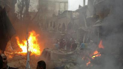 A handout picture released by the Syrian Revolution General Commission (SRGC) shows Syrians inspecting the site of a car bomb attack in the Daf Shawk district of Damascus on October 26, 2012 (AFP Photo/ HO/ Syrian Revolution General Comission) (VIDEO by Alikhbaria Syria from youtube.com)