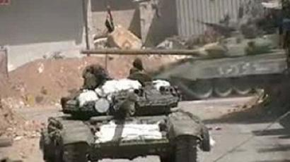 An image grab taken from a video uploaded on YouTube shows Syrian Army tanks patrolling in Duma on the suburb of the capital Damascus on April 6, 2012 (AFP Photo)
