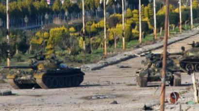 Syrian army tanks are seen stationed at the entrance to Baba Amr neighbourhood in Homs (AFP Photo / Str)