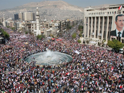 Syria, Damascus: Thousands of Syrians rally to show their support for President Bashar al-Assad, who is facing unprecedented domestic pressure amid a wave of dissent, in Damascus on March 29, 2011 (AFP Photo / Anwar Amro)