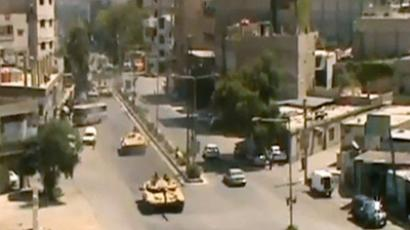 A convoy of tanks in the Damascus suburb of Arbeen (AP video still shot; AP video)