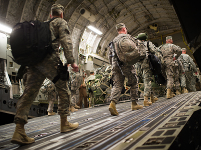 US soldiers board the last C17 aircraft carrying US troops out of Iraq at Camp Adder on the outskirts of the southern Iraqi city of Nasiriyah (AFP Photo / Martin Bureau)