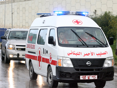 A Red Cross ambulance, Homs (Reuters / Hasan Shaaban)