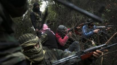 : Armed Syrian men, members of the rebel Free Syrian Army, gather in a mountainous area of the restive Idlib province in northwestern Syria on March 13, 2012 (AFP Photo)