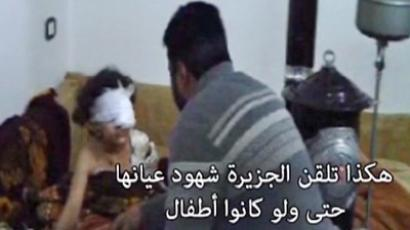 "A still shot from a video from a hospital in Homs. Al Jazeera crew appears to be falsifying a video broadcast, instructing wounded girl to say that ""god will punish"" Bashar Al-Assad."