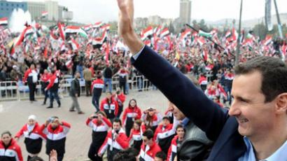 "Syrian President Bashar al-Assad waves at supporters during a rare public appearance in Damascus on January 11, 2012 in which he vowed to defeat a ""conspiracy"" against Syria, a day after he blamed foreign interests for stoking months of deadly violence (AFP Photo / STR)"