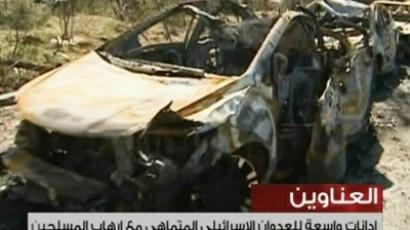 An image grab taken from the state-run Syrian TV on February 2, 2013, shows damaged cars after what Syria said was an Israeli air raid which targeted the Jamraya scientific research base on the outskirts of Damascus (AFP Photo / Syria TV)