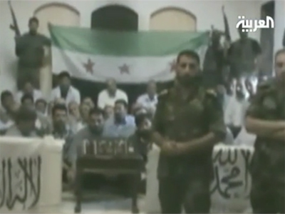 Free Syrian Army claims the Iranians are members of elite Iranian Revolutionary Guards, not pilgrims. (An image from Al Arabiya TV exclusive footage)