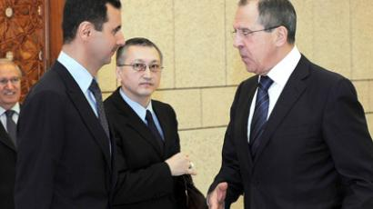 Syria's President Bashar al-Assad (L) talks to Russia's Foreign Minister Sergei Lavrov (R) in Damascus February 7, 2012 (Reuters / SANA)