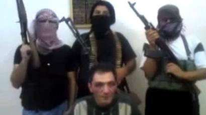 Still from YouTube video of Hassan al-Mikdad in the custody of the Free Syrian Army.