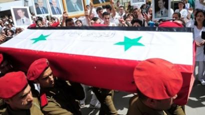 A photo released by the Syrian Arab news Agency (SANA) on April 27, 2011, shows one of 6 coffins of a killed member of either the army or security forces being taken from the October Military hospital in Damascus to their towns and villages for burial, following several days of unrest (AFP Photo)