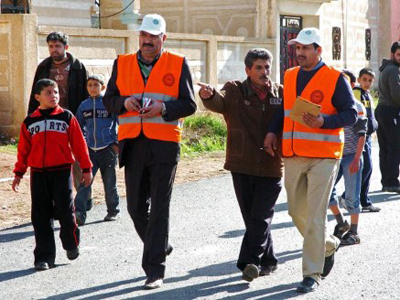 Arab League observers tour the town of Mseifrah in the southern Daraa province (AFP Photo / Youtube)