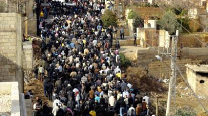 Anti-government protesters attend the funeral of protesters killed in earlier clashes in the Damascus suburb of Zabadani December 21, 2011 (Reuters / Handout)