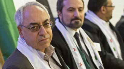 Abdulbaset Sieda, far left, and an unidentified member of the oppositional Syrian National Council (SNC) attend a meeting of the board of the council in the Stockholm suburb Hasselby, on August 31, 2012. (AFP Photo/Leif R Jansson)