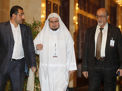 Leading Syrian opposition figure Haitham al-Maleh (R) arrives at the meeting of the General Assembly of the Syrian National Council, in Doha November 8, 2012. (Reutres / Mohamad Dabbouss)