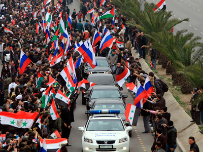 Supporters of Syrian President Bashar al-Assad gather on a Damascus street, to welcome Russian Foreign Minister Sergei Lavrov, February 7, 2012 (Reuters / SANA)