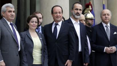 French President Francois Hollande  and Foreign Affairs minister Laurent Fabius pose with Syrian opposition coalition members. France was the first European country to recognize the coalition as the legitimate representative of the Syrian people. (AFP Photo / Kenzo Tribouillard)