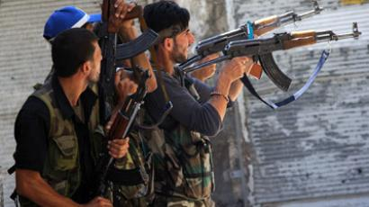 Members of the Free Syrian Army (FSA) shoot at a nearby government army position in the al-Jadeida neighbourhood, in the Old City of Aleppo, on August 21, 2012 (AFP Photo/Phil Moore)
