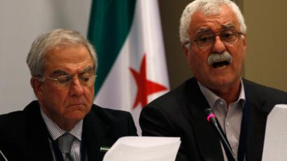Syrian National Council members George Sabra (R) and Samir Nashar address a news conference after their meeting in Istanbul March 27, 2012 (Reuters / Murad Sezer)