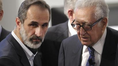 Sheikh Moaz Al-Khatib (left), head of the Syrian oposition talks with Lakhdar Brahimi, Joint Special Representative of the United Nations  and the League of Arab States on Syria. (AFP Photo / Thomas Kienzle)