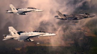 A US Marine Corps F-35 Lightening II multirole fighter jet is escorted by two USMC F-18 Hornets as it flies towards Eglin Air Force Base, Florida in this U.S. Air Force handout photo dated January 11, 2012 (Reuters / DoD / U.S. Air Force / Staff Sgt. Joely Santiago / Handout)
