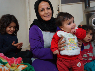 A family of Kurds are not afraid of anything - but they want to return to their homeland. (RT photo / Nadezhda Kevorkova)