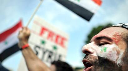 United States, Washington : A man shouts slogans during a demonstration against the Syrian government in front of the White House in Washington, DC, on July 23, 2011. (AFP Photo / Jewel Samad)