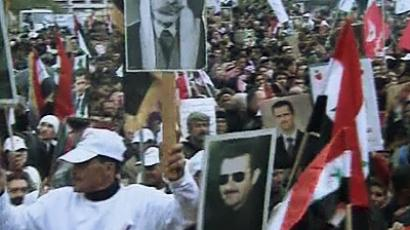 Pro-Assad rally in Damascus. A still shot from AP video.