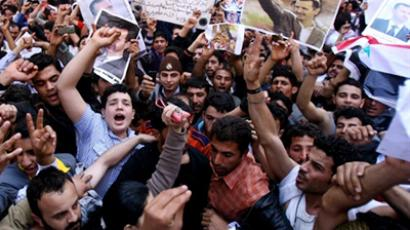 Pro-Syrian government supporter rally outside the Syrian Embassy in Beirut to show their support for President Bashar al-Assad (posters) on March 27, 2011 (AFP Photo / STR)