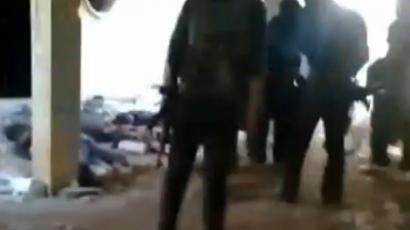 YouTube video screenshot showing rebel fighters