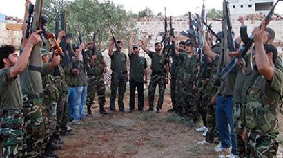 Syria, Idlib: A handout picture released by the Syrian opposition's Shaam News Network on July 13, 2012 shows Free Syrian Army fighters from Katibat al-Farouk training on the outskirts of Idlib on July 12, 2012. (AFP Photo / Shaam News Network)