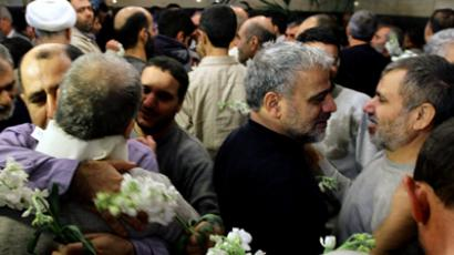 Iranian men who had been held hostage by Syrian rebels since early August congratulate each other as they arrive at a hotel in Damascus after being freed in a prisoner swap on January 9, 2013 (AFP Photo / Louai Beshara)