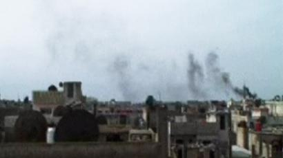 (Skyline of Homs, February 6. AP video still)