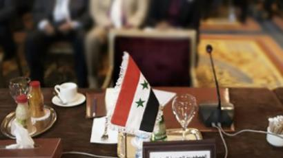 The seat of the Syria's representative at the Arab League is seen empty during a foreign ministers meeting in Cairo on February 12, 2012 (AFP Photo / Marco Longari)