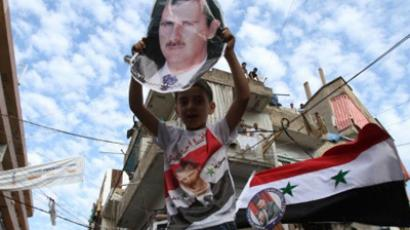 Syrian regime supporters carry pictures of President Bashar al-Assad during a protest in the Nabaa neighborhood of Beirut on October 2, 2011 (AFP Photo / Anwar Amro)