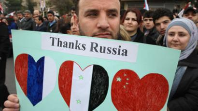 A Syrian pro-government supporter holds upa sign as a convoy carrying Russian Foreign Minister Sergei Lavrov heads towards the presidential palace in Damascus on February 7, 2012. (AFP Photo/Louai Beshara)