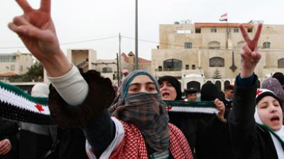 Syrians living in Jordan shout slogans during a demonstration against Syria's President Bashar Al-Assad in front of the Syrian Embassy in Amman, February 6, 2012 (Reuters / Muhammad Hamed)