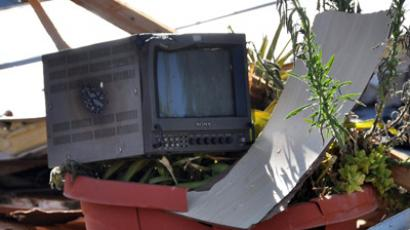"A damaged television monitor rests on debris at the site of an attack on the pro-government Al-Ikhbariya satellite television channel's offices outside Damascus, which killed three staff on June 27, 2012 after President Bashar al-Assad said Syria was in a ""state of war' (AFP Photo / STR)"