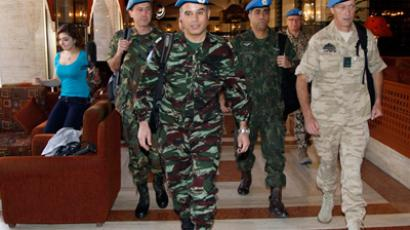 A team of U.N. monitors walk through a hotel in Damascus April 16, 2012 (Reuters/Khaled al- Hariri)