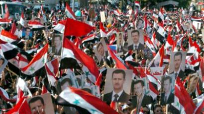 Syria, Latakia: A handout picture released by the Syrian Arab News Agency on October 27, 2011, shows Syrians waving the national flag as they rally during a mass demonstration in support of President Bashar al-Assad, in the city of Latakia of north of Damascus. (AFP Photo / Ho-Sana)