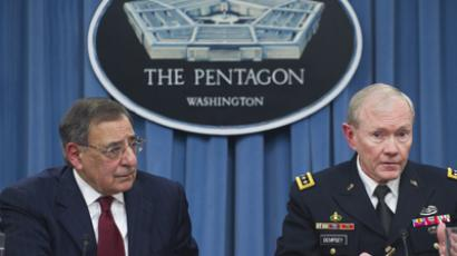 US Secretary of Defense Leon Panetta and Chairman of the Joint Chiefs of Staff Martin Dempsey (R) speak during a press conference at the Pentagon in Washington, DC, on January 10, 2013 (AFP Photo / Saul Loeb)