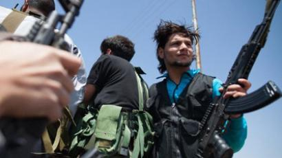 Syrian rebels patrol in Qusayr (AFP Photo / Str)