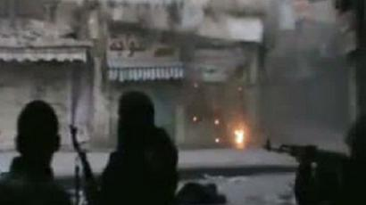 An image grab from a video uploaded on You Tube on February 24, 2012, allegedly shows oppposition fighters battling Syrian regime forces in the Old City of the opposition hub Homs (AFP Photo / Youtube)