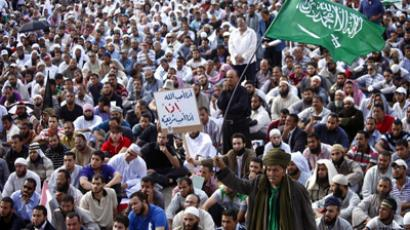An Egyptian Salafist waves a Saudi flag as hundreds gather for a demonstration at Tahrir Square in Cairo to demand that sharia, or Islamic law, be the basis for legislation in a new constitution being drafted for Egypt on November 9, 2012 (AFP Photo / Mahmud Khaled)