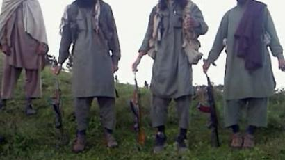 This frame grab taken from undated video footage received August 31, 2012 from the Tehreek-e-Taliban Pakistan show armed Taliban militants standing above severed heads, claimed to be the heads from soldiers they had killed, at an undisclosed location in Pakistan. (AFP Photo/Tehreek-e-Taliban Pakistan)