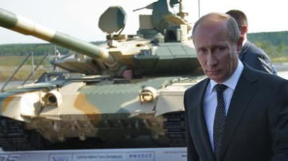 "Prime Minister Vladimir Putin (center) observing T-90AM tank while visiting the 8th International Exhibition of Armament, Military Equipment and Ammunition ""Nizhny Tagil 2011"" on the premises of the Nizhny Tagil Institute of Metal Testing, December 9, 2011 (RIA Novosti / Sergey Mamontov)"
