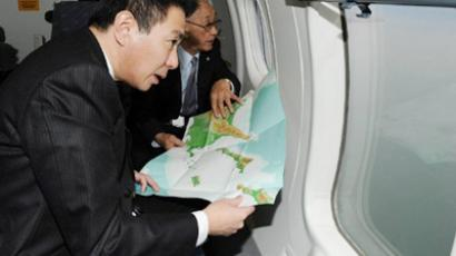 Japanese Foreign Minister Seiji Maehara in a Japan Coast Guard airplane inspects disputed South Kuril Islands on December 4, 2010 (AFP Photo / Japan Pool)